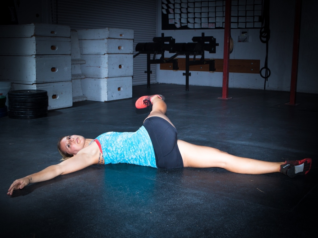 Reclined IT Band Stretch Yoga Pose